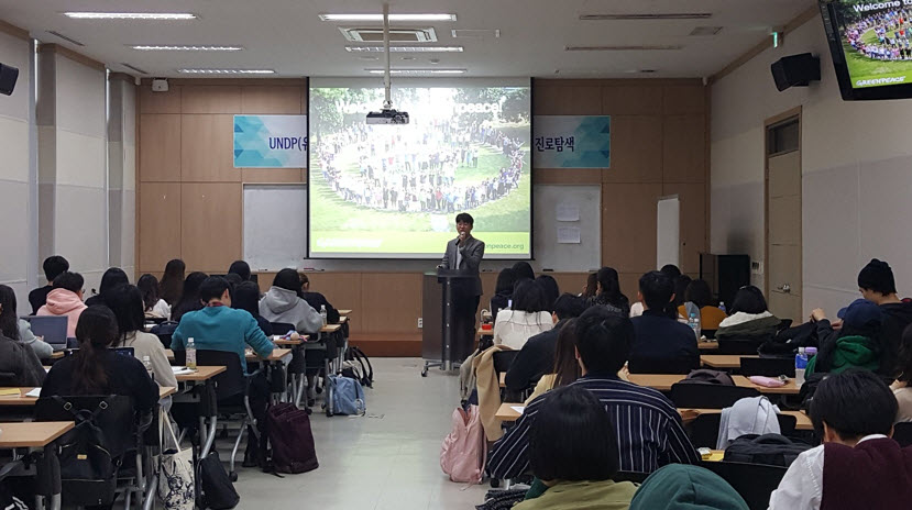 A Green Peace staff gives a lecture to students